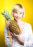Girl with pineapple Stock Photo
