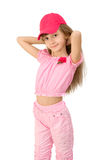 The girl in pink. The girl in a pink suit and a red cap Stock Image