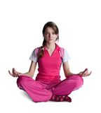 Girl in pink activewear doing yoga Royalty Free Stock Images