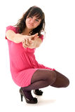 Girl in pink aiming Royalty Free Stock Photography