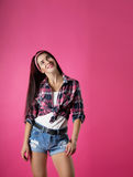 The girl on a pink background Stock Photos