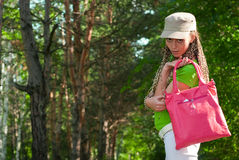 Girl with pink bag Stock Photos
