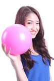 Girl and pink ball Stock Photos