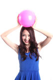 Girl and pink ball Royalty Free Stock Photo