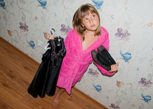 Girl in pink bathrobe. Choose black clothes to wear Stock Image