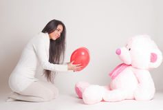 Girl with pink bear Stock Photos