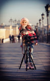 Girl in a pink beret  stand near the camera on a support Stock Photo