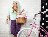 Girl with pink  bike at home Stock Photos