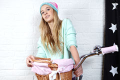 Girl with pink  bike at home Royalty Free Stock Photos
