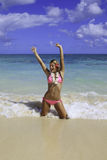 Girl in pink bikini at the beach Royalty Free Stock Image