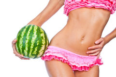 Girl in a pink bikini holding a watermelon Royalty Free Stock Photos