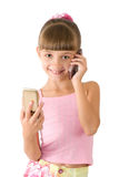 The girl in a pink blouse. With mobiles is photographed on the white background Royalty Free Stock Image