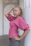 Girl in a pink blouse Royalty Free Stock Image