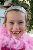 Girl with pink boa. Cute girl with pink feather boa around her neck Stock Photography