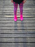 GIRL IN THE PINK BOOTS. ON THE BOARDWALK Stock Images