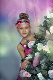 Girl in pink  in Christmas Stock Photo