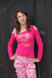 Girl in pink clothes stock photography