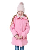 Girl in pink coat standing shy, isolated Royalty Free Stock Photography