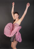 Girl in pink corset and skirt. Dancing girl in pink corset and skirt stock images