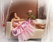 Girl in pink is on the couch Stock Photo