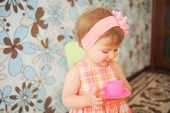 Girl with Pink Cup and Saucer Stock Image