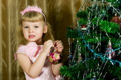 Girl in pink decorated Christmas tree Stock Images