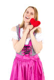 Girl in pink dirndl happy about upcoming valentines day Stock Photo