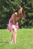 Girl in pink dress. Beautiful girl in pink dress in summer day Royalty Free Stock Photo