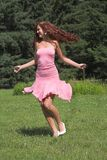 Girl in pink dress. Beautiful girl in pink dress in summer day Stock Photography