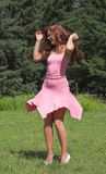 Girl in pink dress. Beautiful girl in pink dress in summer day Royalty Free Stock Images