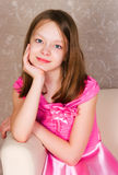 Girl in a pink dress Royalty Free Stock Image