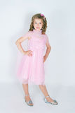 The girl in a pink dress Stock Photos