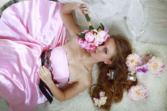 Girl in pink dress with bouquet of flowers Royalty Free Stock Images