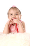 Girl in a pink dress dreams. Studio shot of young girl Royalty Free Stock Images