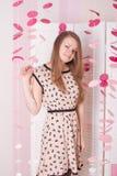 Girl in the pink dress  elegant bedroom Stock Image