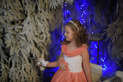 Girl in pink dress festive in the fairy forest. Girl in a smart pink dress festive in the fairy forest Royalty Free Stock Photos