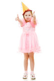 A girl in a pink dress and festive hat Stock Photography