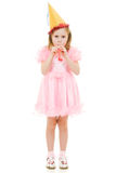 A girl in a pink dress and festive hat Royalty Free Stock Image