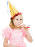 A girl in a pink dress and festive hat Royalty Free Stock Photos