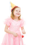 A girl in a pink dress and festive hat laughing. Happy girl in a pink dress and festive hat laughing on white background Stock Images