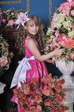 Girl in a pink dress among the flowers Royalty Free Stock Photography