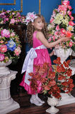 Girl in a pink dress among the flowers Royalty Free Stock Photo