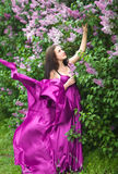 Girl in a pink dress flying