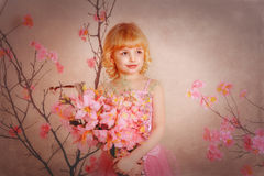 Girl in a pink dress. In the hands of flowers Royalty Free Stock Image
