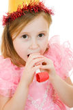 Girl in a pink dress and hat blowing in the pipe Royalty Free Stock Photography