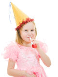Girl in a pink dress and hat blowing in the pipe Stock Image