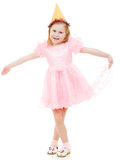 A girl in a pink dress and hat dances Stock Images