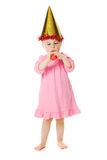 Girl in pink dress and a hat on his birthday Royalty Free Stock Photo