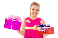 Girl in pink dress holding gifts Stock Images