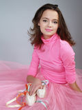 Girl in a pink dress holds pointes in the hands Royalty Free Stock Photo